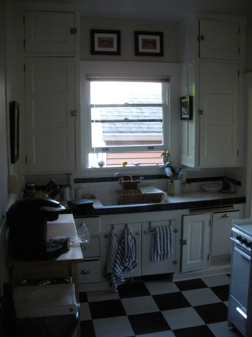 View of the kitchen from the front hallway. Great, great window.