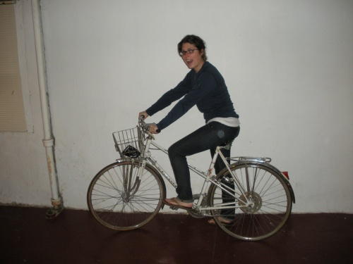 Morgen happily pretending to ride Claude in the basement of our building. Doesn't she just look like a natural?