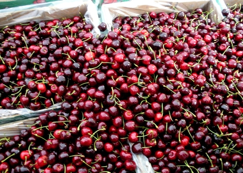 Cherries overflowing at one booth.