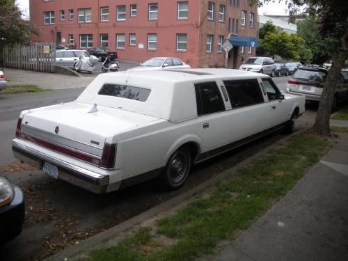 A Lincoln limousine. That could not have been easy to parallel-park.