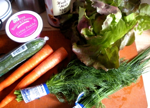 The ingredients on hand, including walnut oil, creme fraiche and various vegetables