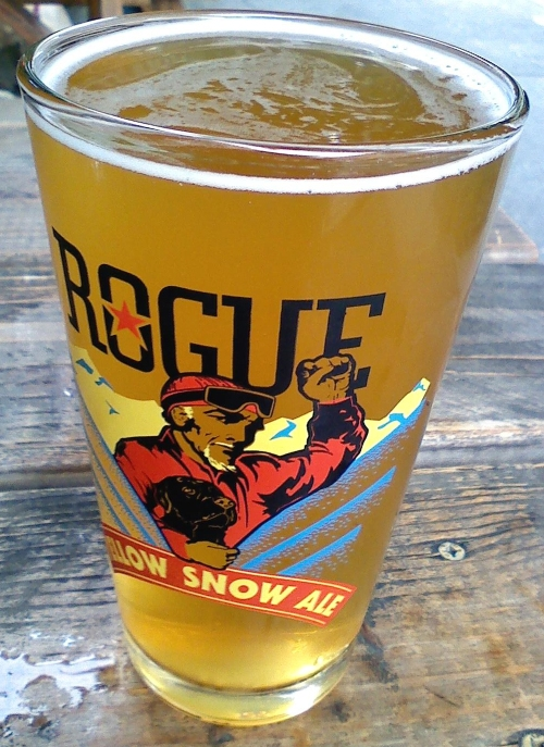 Rogue's light and refreshing Honey Orange Wheat. Note the glass for Rogue's Yellow Snow Ale, a winter seasonal brew I think.