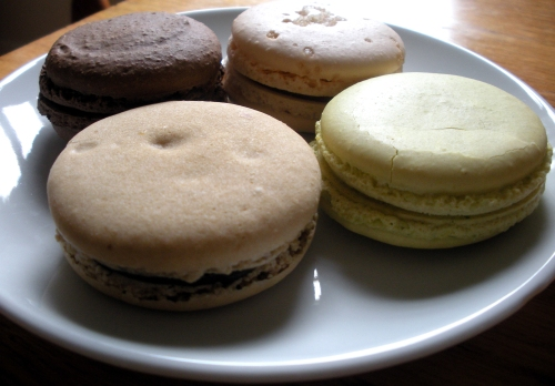 Moonstruck macarons. Flavors clockwise from top left: chocolate, salted caramel, pistachio and coffee.